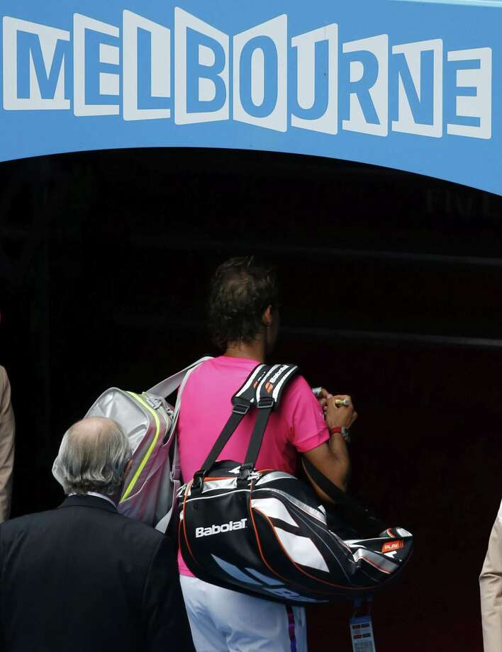 Rafael Nadal walks off Rod Laver Arena after his quarterfinal loss to Tomas Berdych at the Australian Open on Tuesday in Melbourne. Photo: Vincent Thian — The Associated Press  / AP