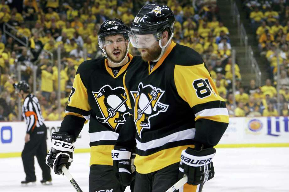 Pittsburgh Penguins' Sidney Crosby (87) and Phil Kessel (81) prepare for a face-off during the second period of Game 7 of the Stanley Cup Eastern Conference finals against the Tampa Bay Lightning Thursday in Pittsburgh. The Penguins won 2-1. Photo: The Associated Press  / AP