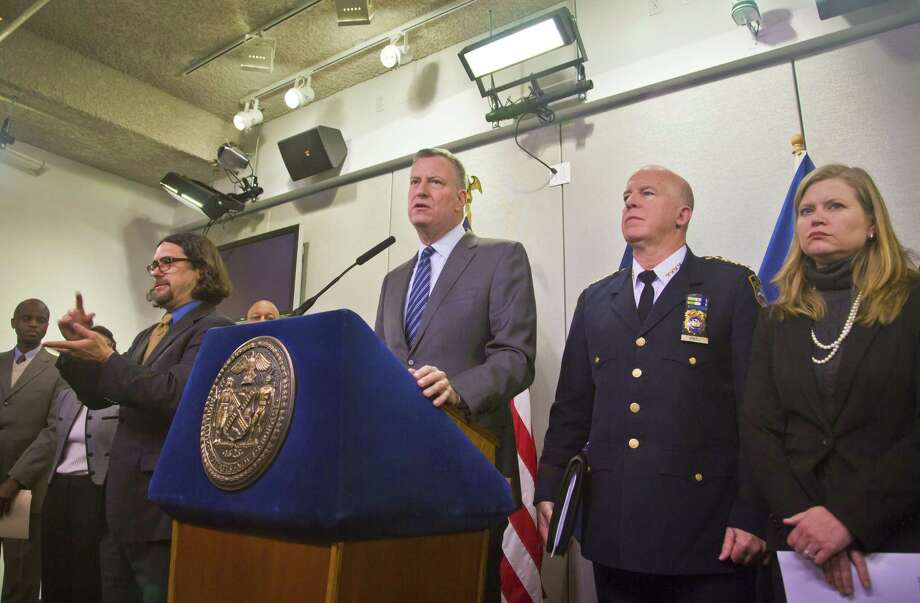 New York City Mayor Bill de Blasio, center, and top city officials hold a press conference at the Office of Emergency Management on Monday in New York. Photo: Bebeto Matthews — The Associated Press  / AP
