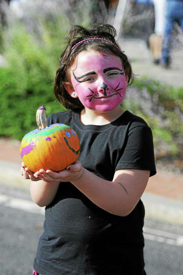 File photo - The Register Citizen A child shows off her painted pumpkin and her painted face at a previous Winsted Fall Festival. Children's activities are a highlight of the event, as well as food, shopping and contests. The festival is hosted by the Friends of Main Street and is set for Saturday, Oct. 1. Photo: Journal Register Co.