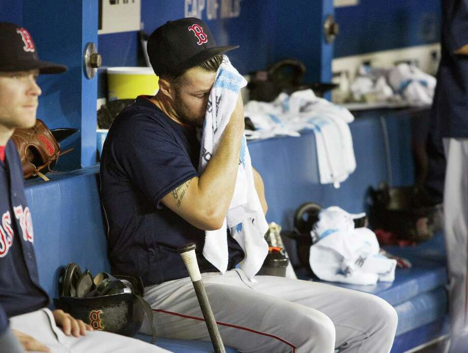 Red Sox starting pitcher Joe Kelly sits in the dugout in the fifth inning after being taken out of the game on Friday. Photo: Fred Thornhill — The Canadian Press Via AP  / The Canadian Press