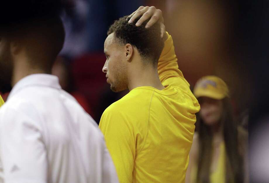 Golden State Warriors guard Stephen Curry (30) returns to the game, after being injured in a fall earlier, during the second half in Game 4 of the NBA basketball Western Conference finals against the Houston Rockets, Monday, May 25, 2015, in Houston. (AP Photo/David J. Phillip) Photo: AP / AP