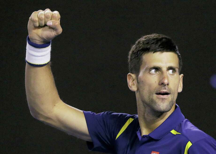 Novak Djokovic celebrates after defeating Kei Nishikori in their quarterfinal match at the Australian Open on Tuesday. Photo: Aaron Favila — The Associated Press  / AP