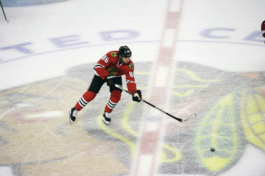 Blackhawks right wing Patrick Kane moves the puck up the ice against the Detroit Red Wings during a preseason game on Tuesday in Chicago. Photo: David Banks — The Associated Press  / FR165605 AP