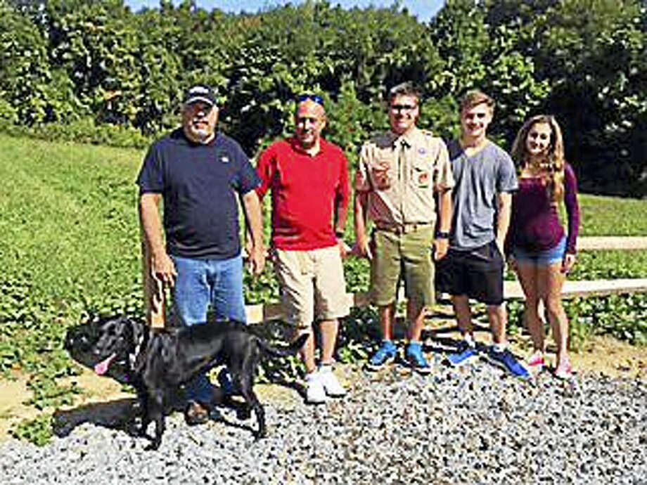 Photos courtesy of Shelli Rhoads From left are Dan Rhoads, Paul Rhoads, Jordan Rhoads, Devin Rhoads, Michaela McNutt and Luci, the black lab. The group, led by Jordan Rhoads, upgraded the Antolini Trail in New Hartford for Jordan's Eagle Scout project. Photo: Journal Register Co.