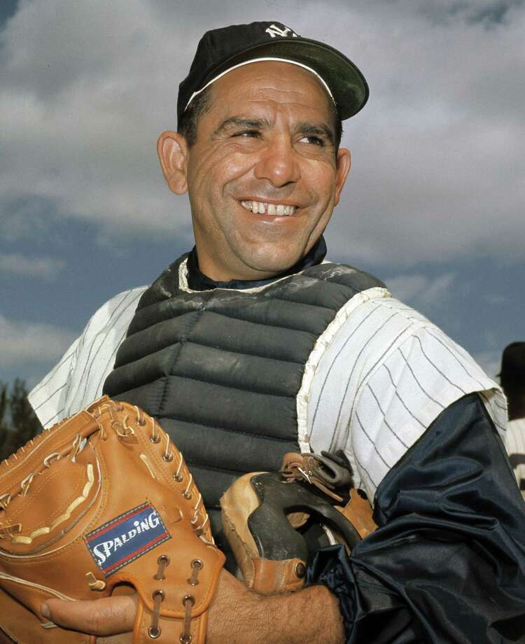 """In this undated file photo, New York Yankees catcher Yogi Berra poses at spring training in Florida. The Hall of Fame catcher renowned as much for his lovable, linguistically dizzying """"Yogi-isms"""" as his unmatched 10 World Series championships with the Yankees died on Tuesday at 90. Photo: The Associated Press File Photo  / AP"""