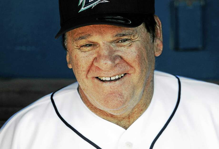 In this June 16, 2014 photo, Pete Rose sits in the dugout at The Ballpark at Harbor Yard in Bridgeport, Conn. Photo: AP Photo/Jessica Hill, File  / AP2014