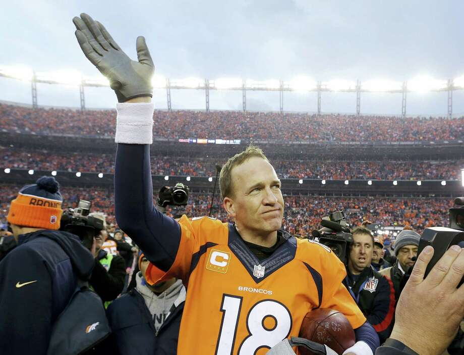 Broncos quarterback Peyton Manning waves to spectators following Sunday's AFC Championship game. Photo: The Associated Press  / AP