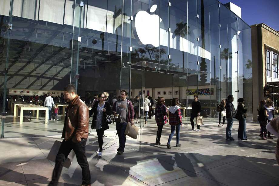 In this Jan. 3 photo, shoppers walk by the Apple Store along the the Third Street Promenade in Santa Monica, Calif. Photo: AP / AP
