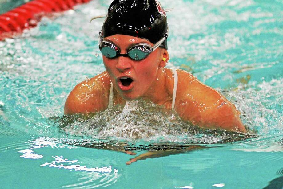 Torrington's Victoria Masucci takes first place in the 100 yard breaststroke. Photo: MARIANNE KILLACKEY — REGISTER CITIZEN  / 2015