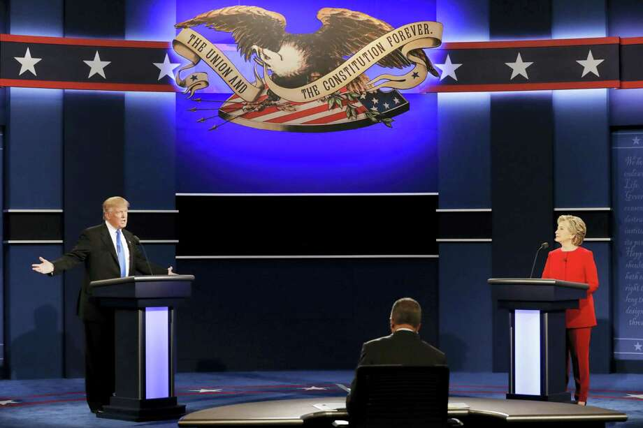 Republican presidential nominee Donald Trump answers a question as Democratic presidential nominee Hillary Clinton listens during the presidential debate at Hofstra University in Hempstead, N.Y., Monday, Sept. 26, 2016. Photo: AP Photo/David Goldman   / Copyright 2016 The Associated Press. All rights reserved.