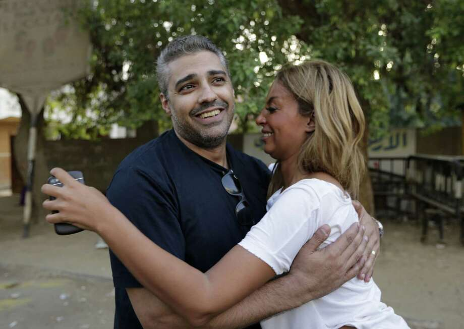 Canadian Al Jazeera English journalist Mohamed Fahmy hugs his wife Marwa Omara after being released from Torah prison in Cairo, Egypt, Wednesday, Sept. 23, 2015. Fahmy and his colleague Baher Mohammed were among a group of 100 people pardoned by Egyptian President Abdel-Fattah el-Sissi on the eve of the major Muslim holiday of Eid al-Adha. The pardon also comes a day before the Egyptian leader is to travel to New York to attend the United Nations General Assembly. Photo: AP Photo/Amr Nabil  / AP