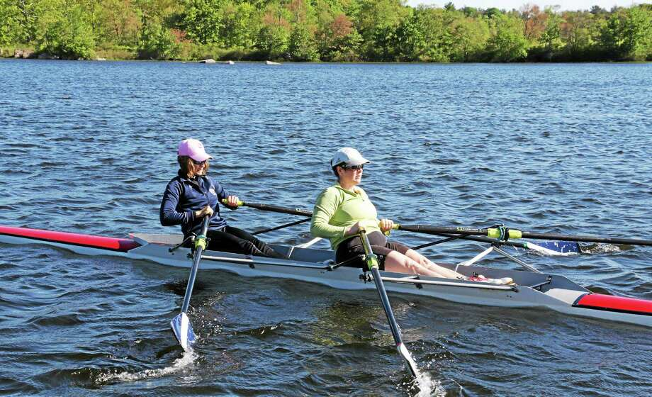 Kathy Roy and Anne Hermans enjoy a morning on Bantam Lake. Photo: John Fitts – The Register Citizen