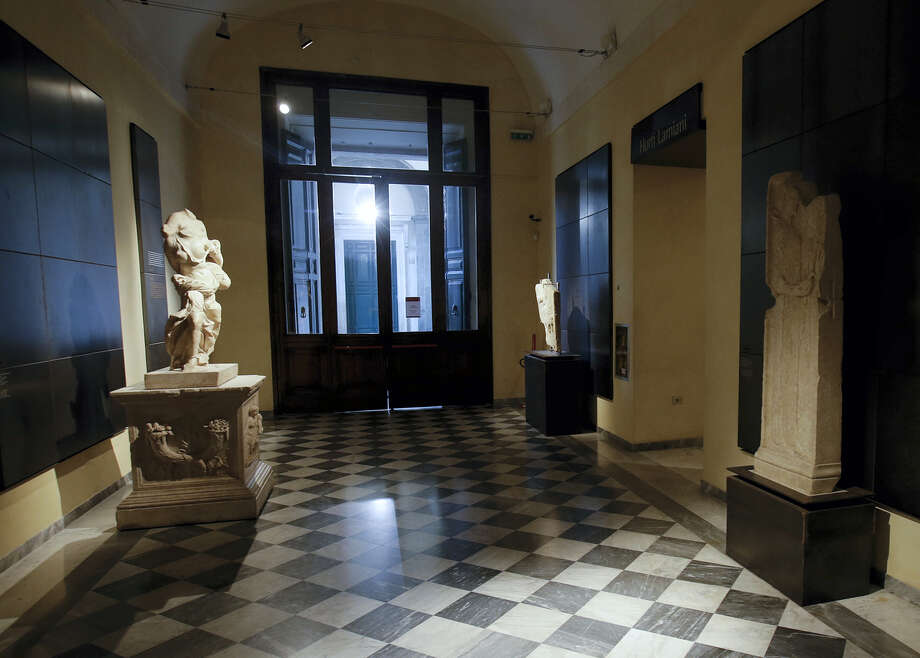 """Some of the statues that were covered up with wooden panels on the occasion of Iranian President Hassan Rouhani's visit are seen at the Capitoline Museums, in Rome, Tuesday, Jan. 26, 2016. A kind of """" classics coverup """" is causing a political flap in Italy, after ancient nude statues in a museum were hidden from view so the Iranian president would not take offense. Photo: AP Photo/Gregorio Borgia   / AP"""