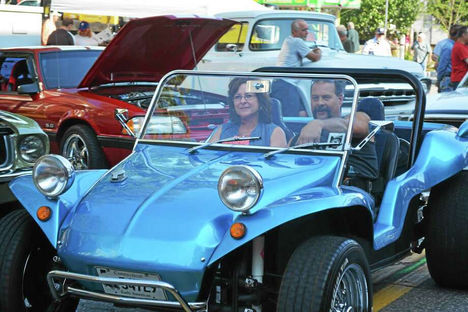Car enthusiasts cruise down Main Street during last year's car show. Photo: Register Citizen File Photo