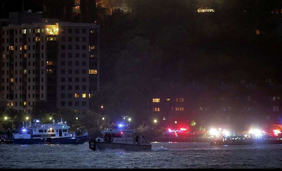 In this photo taken from video, search and rescue boats look for a small plane that went down in the Hudson River, Friday, May 27, 2016, near West New York, N.J. The Federal Aviation Administration says it received a report a World War II vintage P-47 Thunderbolt aircraft may have gone down in the river two miles south of the George Washington Bridge. Photo: AP Photo — Julie Jacobson / Copyright 2016 The Associated Press. All rights reserved. This material may not be published, broadcast, rewritten or redistribu