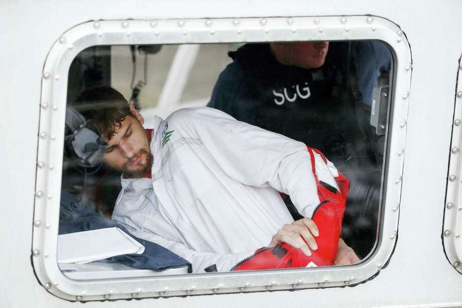 Nathan Carman prepares to disembark from a small boat at the US Coast Guard station in Boston, Tuesday. Carman spent a week at sea in a life raft before being rescued by a passing freighter. Photo: Michael Dwyer — The Associated Press  / Copyright 2016 The Associated Press. All rights reserved.