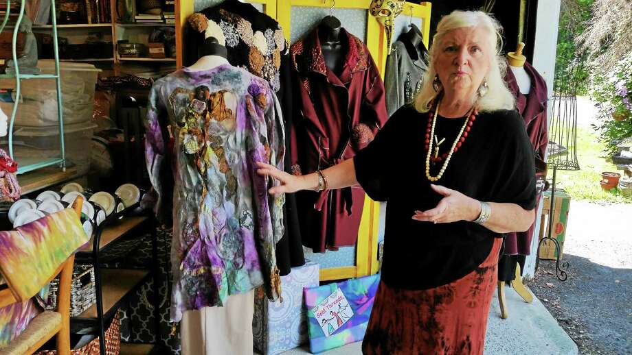 Doreen Breen, proprietor of Soul Threads, makes one-of-a-kind women's clothing and accessories using regular and discharge dyeing methods as well as nuno felting (the technique of fusing wool fabric into silk gauze). Photo: Photo By N.F. Ambery