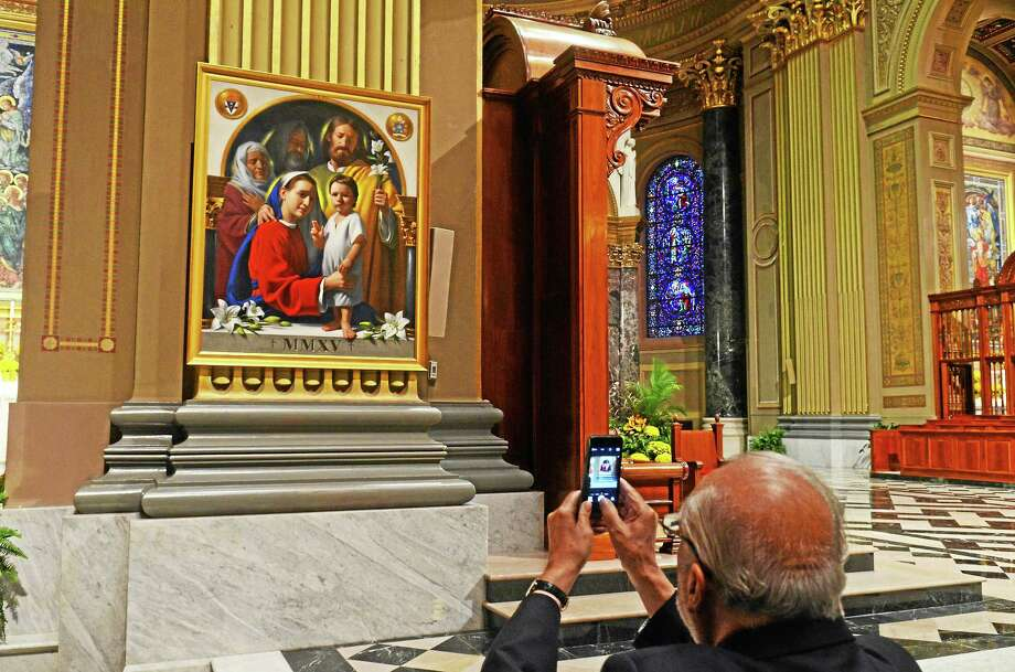 """A man photographs the painting """"The Holy Family""""  at Cathedral Basicala  of Saints Peter and Paul in Phladelphia.  Tuesday, September 22, 2015. Photo: (Geoff Patton - The Reporter)"""