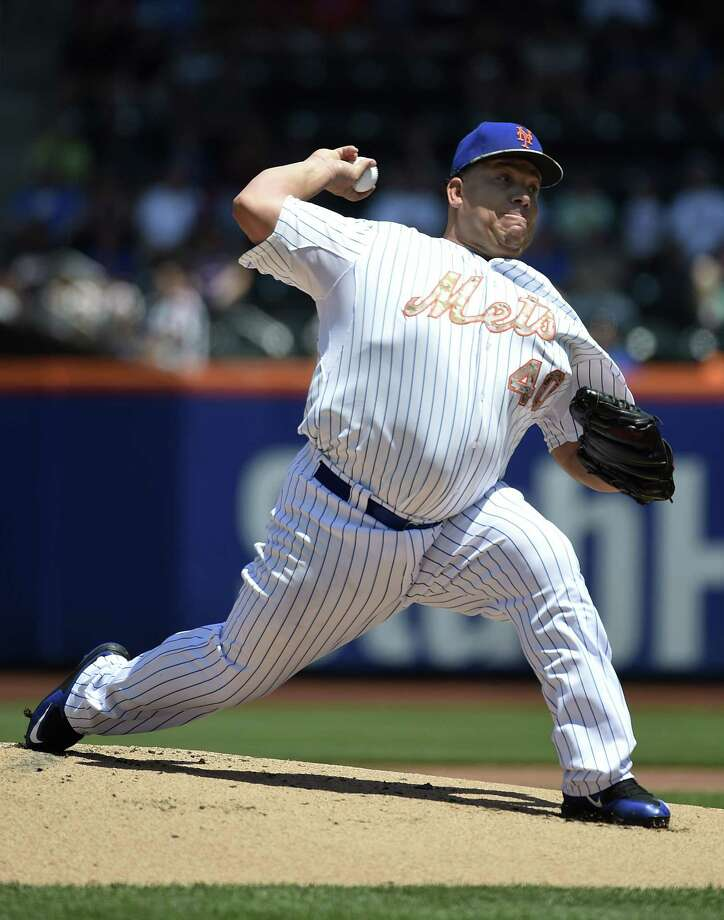Mets starter Bartolo Colon pitches in the first inning against the Philadelphia Phillies on Monday in New York. Photo: Kathy Kmonicek — The Associated Press  / FR170189 AP