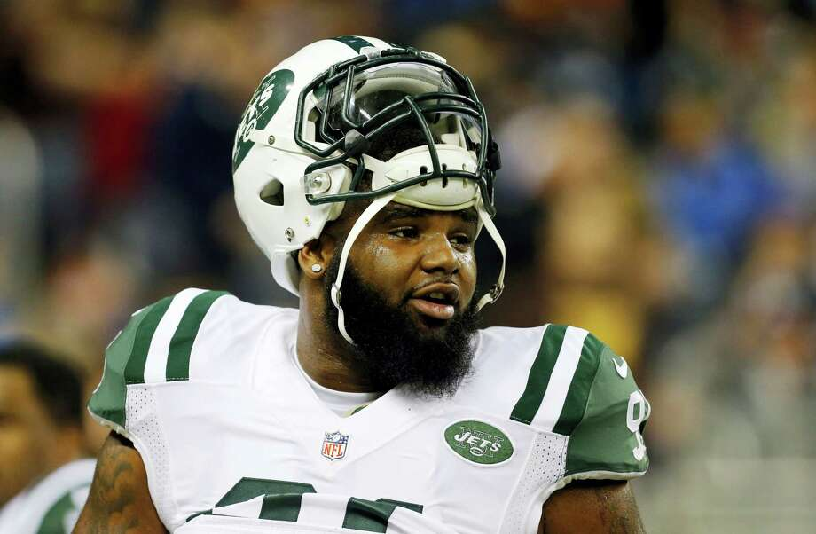 FILE - In this Nov. 24, 2014, file photo, New York Jets defensive end Sheldon Richardson watches during warmups before an NFL football game against the Buffalo Bills in Detroit. Richardson is preparing to play at the start of the season, even if the NFL might consider handing down a suspension. Photo: The Associated Press  / AP