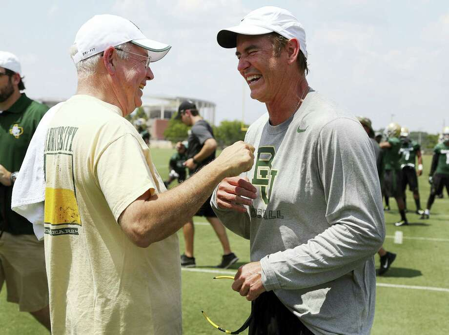 "Rod Aydelotte/Waco Tribune-Herald via AP, File In this Aug. 5, 2014, file photo,Baylor University President Ken Starr, left, jokes with head football coach Art Briles, right, on the first day of NCAA college football practice in Waco, Texas. Baylor University's board of regents says it will fire Briles and re-assign Starr in response to questions about its handling of sexual assault complaints against players.  The university said in a statement Thursday, May 26, 2016, that it had suspended Briles ""with intent to terminate.""  Starr will leave the position of president on May 31, but the school says he will serve as chancellor. Photo: AP / Waco Tribune Herald"