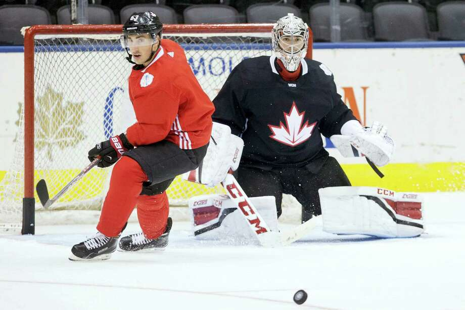 Canada's Brad Marchand, left, and Carey Price watch the puck during practice at the World Cup of Hockey in Toronto on Friday. Photo: Chris Young — The Canadian Press Via AP  / CP