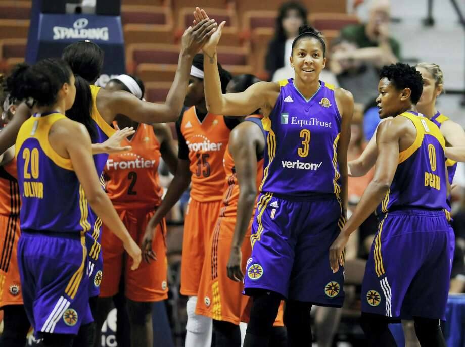 The Sparks' Candace Parker, high-fives Nneka Ogwumike, second from left, during the first half on Thursday. Photo: Jessica Hill — The Associated Press  / AP2016