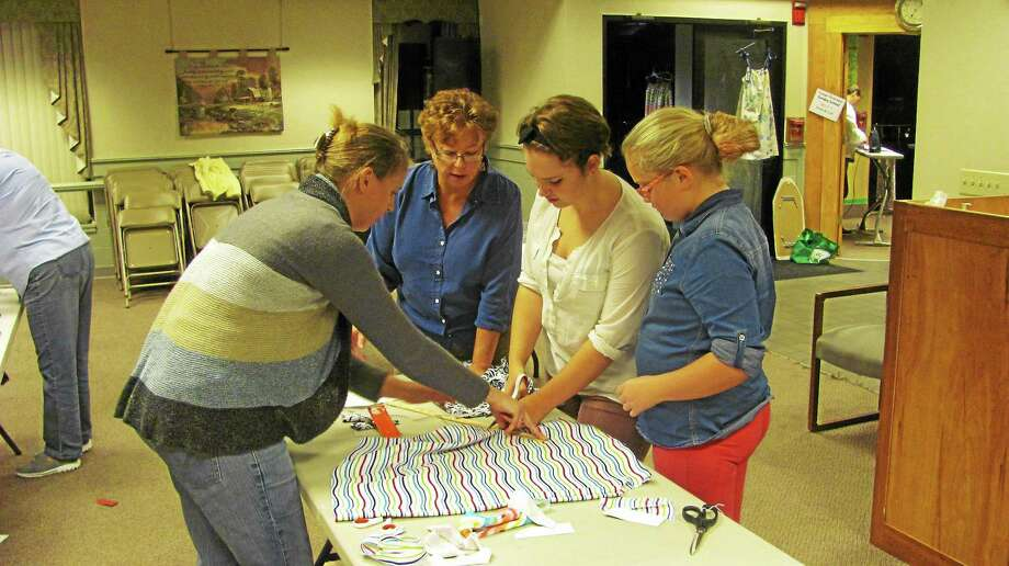 Community members gathered at Northwest Hills Community Church in Torrington last fall to help sew dresses for African children. Photo: Register Citizen File Photo