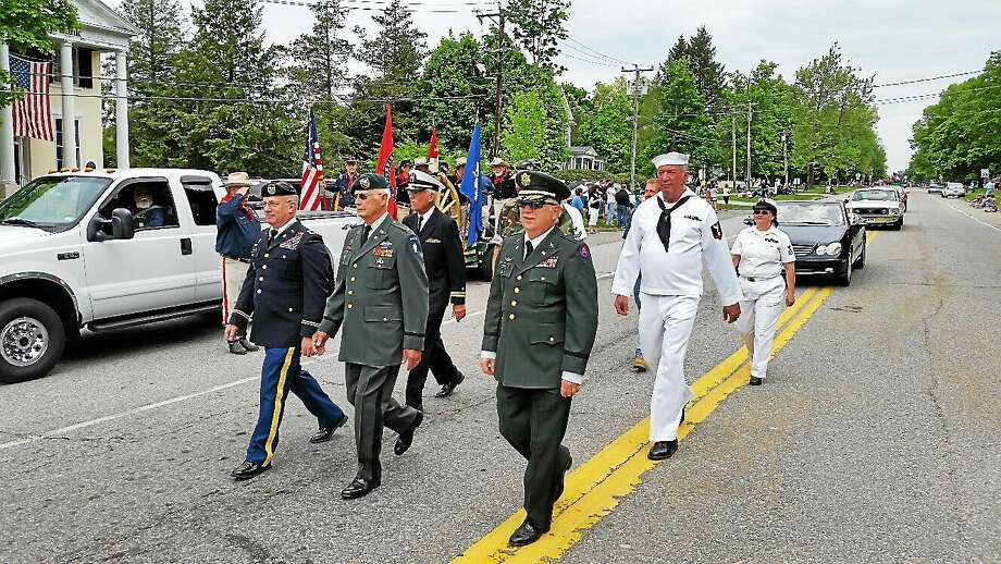 Local veterans marched down Route 63 at the Litchfield Memorial Day Parade on Monday morning. The parade also featured appearances by school bands, the Litchfield 4-H Fair Association, and local emergency vehicles. The parade preceded a ceremony on the Litchfield Town Green with speeches by Litchfield First Selectman Leo Paul Jr. and Col. Mark Yanaway of Litchfield. Photo: Photo By N.F. Ambery