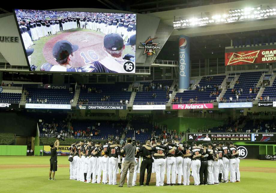 Marlins players gather around the pitching mound in honor of pitcher Jose Fernandez after Monday's game against the Mets. The Marlins won 7-3. Photo: Lynne Sladky — The Associated Press  / Copyright 2016 The Associated Press. All rights reserved.