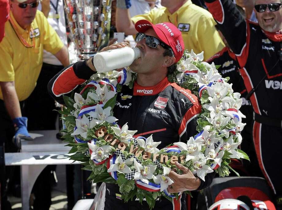 Juan Pablo Montoya celebrates after winning the 99th running of the Indianapolis 500 on Sunday. Photo: Darron Cummings — The Associated Press  / AP
