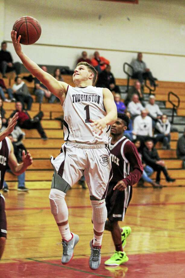 Photo by Marianne KillackeyTorrington's Zak Mancini scored inside and out on his way to 31 points and a 71-64 win over Naugatuck Monday at Torrington. Photo: Journal Register Co. / 2015