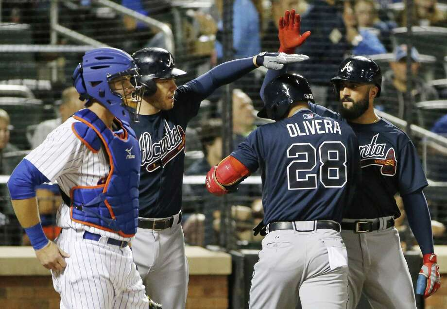 Hector Olivera and the Atlanta Braves beat Kevin Plawecki and the New York Mets 6-2 on Tuesday at Citi Field. Photo: Kathy Willens — The Associated Press  / AP