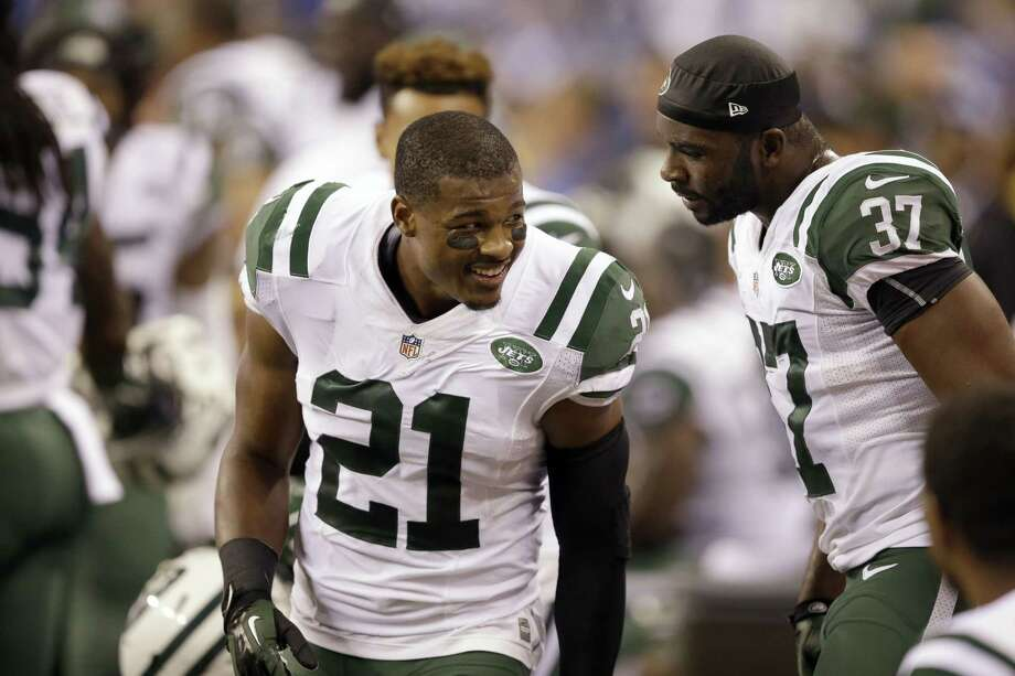 Strong safety Marcus Gilchrist (21), free safety Jaiquawn Jarrett (37) and the New York Jets are 2-0. Photo: Darron Cummings — The Associated Press  / AP