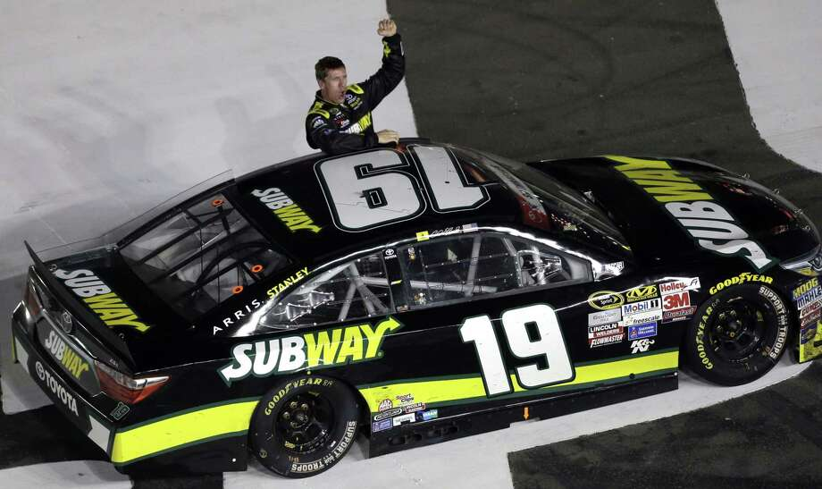 Carl Edwards celebrates after winning the Coca-Cola 600 on Sunday in Concord, N.C. Photo: Gerry Broome — The Associated Press  / AP