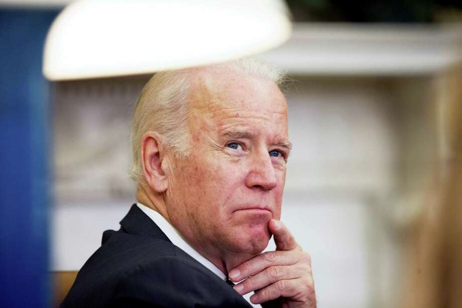 "In this May 20, 2016, file photo, Vice President Joe Biden listens May 24, 2016, as President Barack Obama speaks to members of the media in the Oval Office at the White House in Washington. Motivated by the cancer death of his son, Beau, Biden will bring together scientists, oncologists, donors and patients for a national conference on cancer research in Washington. Dubbed the ""National Cancer Moonshot Summit,"" the summit is scheduled for June 29 at Howard University, and the White House said it planned to organize dozens of regional summits on the same day in communities far from the capital. Photo: AP Photo/Andrew Harnik   / Copyright 2016 The Associated Press. All rights reserved. This material may not be published, broadcast, rewritten or redistribu"