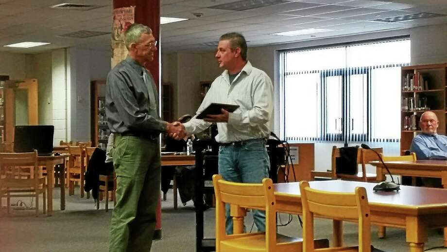 Torrington High School art teacher Victor Leger received his plaque for winning the Outstanding Secondary Art Educator Award for Connecticut at the Board of Education's meeting Wednesday. Photo: Amanda Webster — The Register Citizen