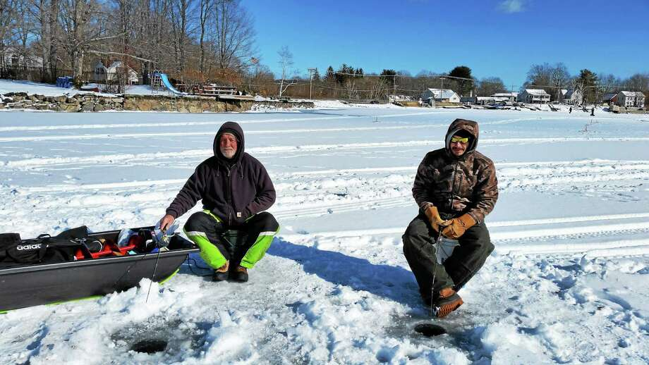 Anglers Bo Groman of Winsted and Wayne Serge of Riverton are pictured at Northwest Sporting Goods & Supply's third annual Ice Fishing Derby at Highland Lake on Sunday. Photo: N.F. Ambery — Special To The Register Citizen