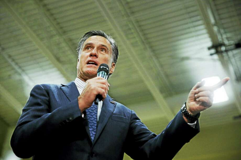 THE ASSOCIATED PRESS FILE PHOTO Mitt Romney speaks at a campaign stop for then-Republican presidential candidate Ohio Gov. John Kasich March 14 at Westerville Central High School in Westerville, Ohio. Photo: AP / AP