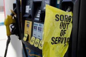 A sign informs customers the gas station is out of unleaded gas on League Line Road, Thursday, Aug. 24, 2017, in Conroe.