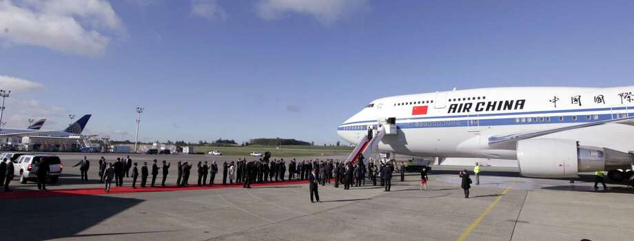 AP Photo/Elaine Thompson  A line of dignitaries greet Chinese President Xi Jinping and first lady Peng Liyuan upon their arrival Tuesday, Sept. 22, 2015, at Boeing Field in Everett, Wash. Xi is spending three days in Seattle before traveling to Washington, D.C., for a White House state dinner on Friday. Photo: AP / AP