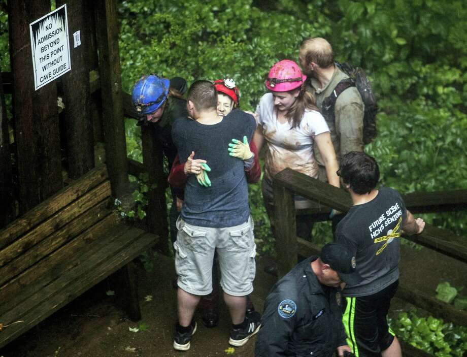 Tour guide Peggy Nims hugs a friend after she made it out of Hidden River Cave on Thursday, May 26, 2106, after 18 people on a cave tour were trapped due to flash flood waters in Horse Cave, Kentucky. Photo: AP Photo — Daily News, Austin Anthony / Daily News