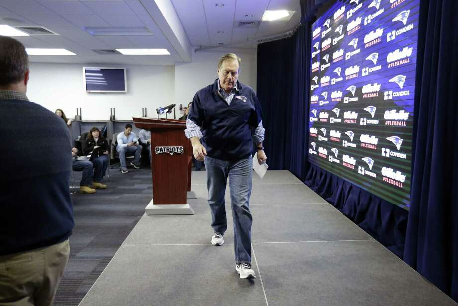 "New England Patriots head coach Bill Belichick leaves the podium after speaking at a news conference Saturday at Gillette Stadium in Foxborough, Mass., where he defended the way his team preps its game balls. Whatever happened, and whatever is going to happen, Register sports columnist Chip Malafronte just wants this episode of ""CSI: PSI"" to be over soon. Photo: Steven Senne — The Associated Press  / AP"