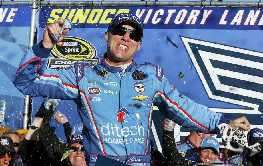 Kevin Harvick celebrates in Victory Lane after winning at New Hampshire Motor Speedway on Sunday. Photo: Jim Cole — The Associated Press  / Copyright 2016 The Associated Press. All rights reserved.