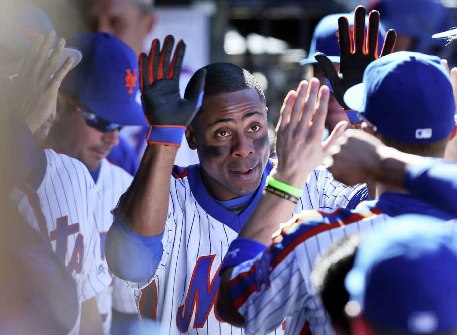 Curtis Granderson is greeted by teammates in the dugout after hitting a solo home run in the fourth inning Sunday. Photo: Seth Wenig — The Associated Press  / Copyright 2016 The Associated Press. All rights reserved.
