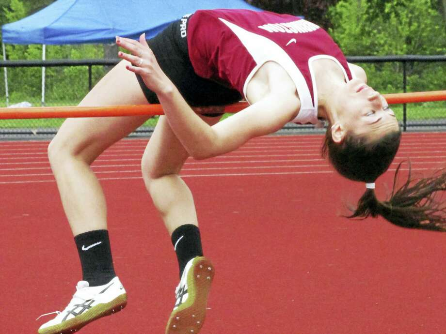 Torrington's Ashlynn Cook finished second to a NVL meet record performance by Woodland's Kelly Ward in the high jump. Photo: Photo By Peter Wallace