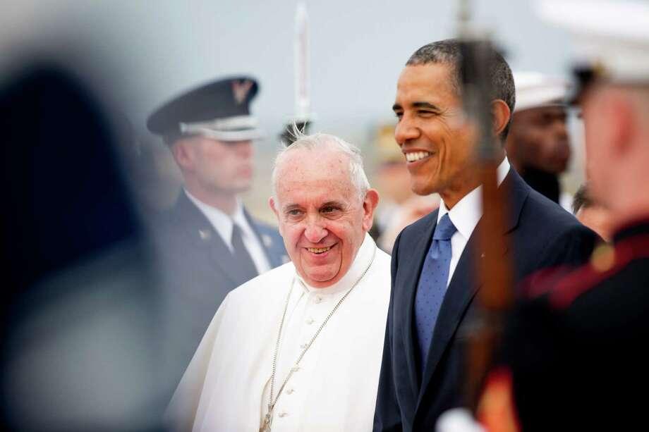 President Barack Obama walks across the tarmac with Pope Francis upon his arrival at Andrews Air Force Base, Maryland, Tuesday. Photo: Andrew Harnik — ASSOCIATED PRESS  / AP