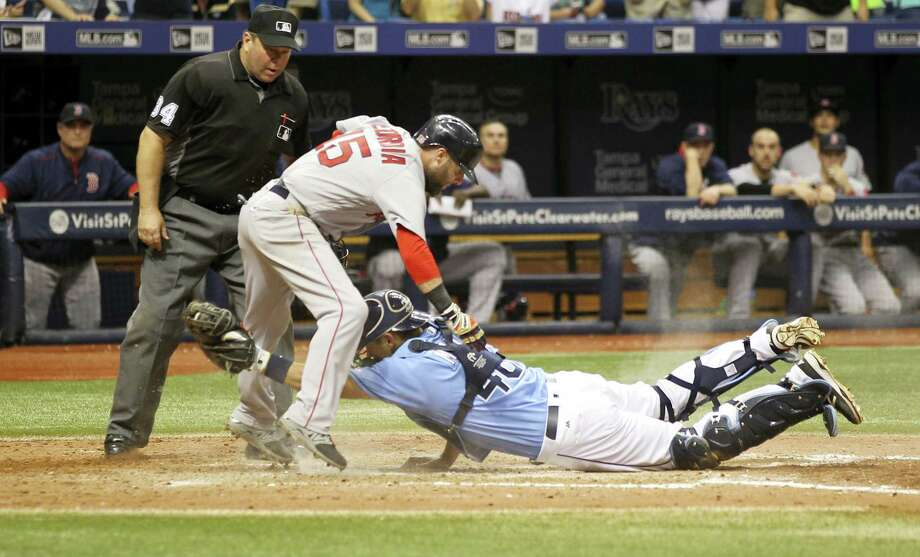 Dustin Pedroia scores a run on a fielding error by Rays catcher Luke Maile in the 10th inning on Sunday. Photo: The Associated Press   / FR596 AP