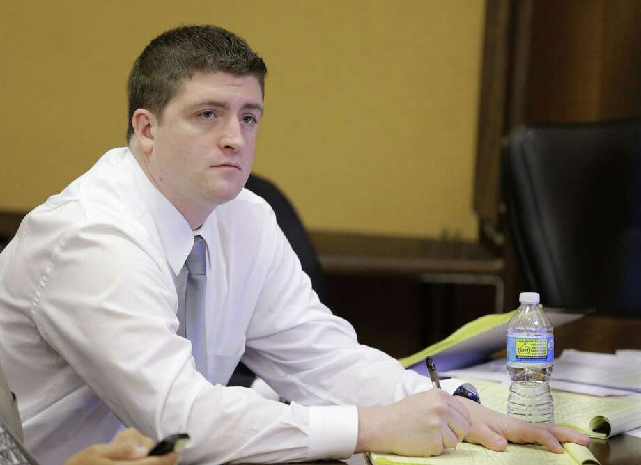 FILE - In this April 9, 2015, file photo, Cleveland police Officer Michael Brelo listens to testimony during his trial in Cleveland.   Brelo has been found not guilty in the shooting deaths of two unarmed suspects in a 137-shot barrage of police gunfire after a high-speed chase. The judge's verdict Saturday, May 23, 2015 for Brelo  comes after a four-week trial on two counts of voluntary manslaughter in the deaths of Timothy Russell and Malissa Williams on Nov. 29, 2012. (AP Photo/Tony Dejak, Pool, File) Photo: AP / Pool AP